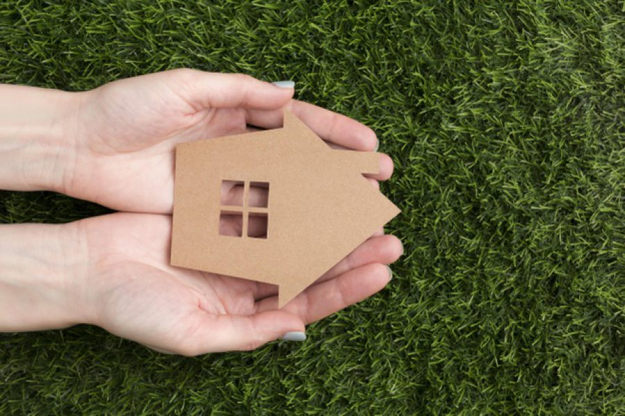 hands-with-miniature-house_23-2148576685
